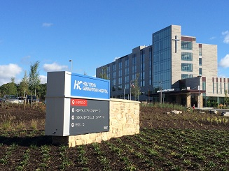 Holy Cross Hospital monument sign and bldg 9-22-2014 low Res
